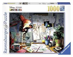 amazon com ravensburger disney pixar the artist u0027s desk puzzle