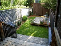 lovely backyard desaign ideas with large fence and wooden stair
