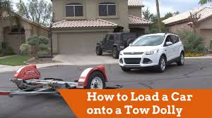 how to load a car onto a u haul tow dolly youtube