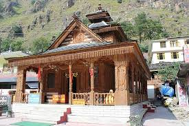 temple made from wood near the gurudwara picture of manikaran