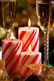 closeup of peppermint candles flutes of champaine champagne