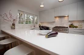 white quartz countertops with white wooden kitchen cabinet with