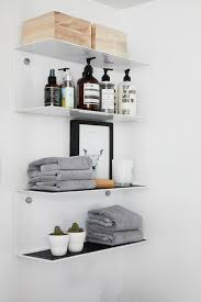 glass bathroom shelves furnish your bathroom with designer bathroom shelf boshdesigns com