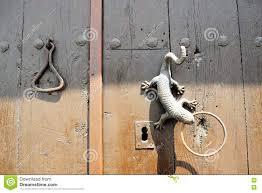 unique art doorknocker in frigiliana spanish white village