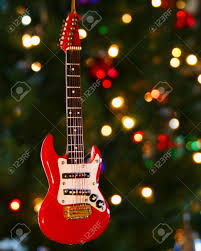 a electric guitar ornament and lights on a tree