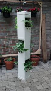 simple hanging planter made with a pvc fence post two post caps