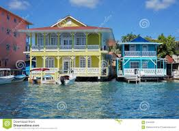 Colonial American Homes by Typical Caribbean Colonial Homes Over The Water Stock Photo