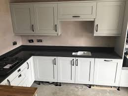 grey kitchen cupboards with black worktop black granite worktop trends omega