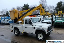 lifted land rover defender 2009 land rover defender 4x4 powered access platform cherry picker