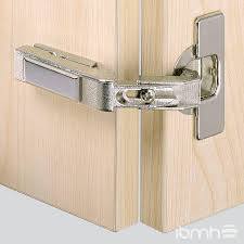 where to put handles on kitchen cabinets installing a kitchen cabinet hinge
