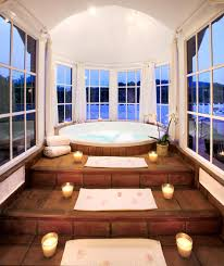 jacuzzi bathtub with candled steps and round windows dream