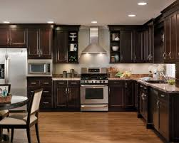 traditional adorable dark maple kitchen cabinets at kitchens with cool dark kitchen cabinets with light wood floors 3442 home and in
