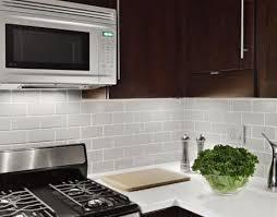grey tile backsplash white countertops cherry cabinets kitchen