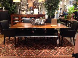arhaus dining table high back chairs sit perfectly at the head of