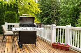 photo of large barbecue cooker on cedar deck with patio furniture