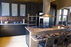plain kitchen island designs with cooktop microwave and breakfast