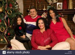 puerto rican family in america has a family portrait in front of