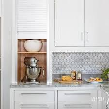 Small Kitchen Appliances Garage With Tiled Backsplash by White Cabinets With White Marble Hex Backsplash Cottage Kitchen