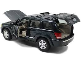 jeep cherokee toy golden deep green 1 18 maisto diecast jeep grand cherokee model