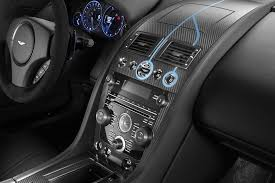 aston martin cars interior q by aston martin showing four new models at pebble beach