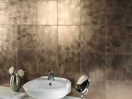 bathroom shining circle themed bathroom tile designs in gold bathroom attractive circular patterned of shiny bronze bathroom tile designs with hand mirror and flower