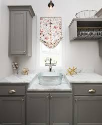 gray laundry room cabinets with bucket sink transitional