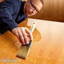 how do i get a smooth finish on kitchen cabinets the diy guide to finishing a table top family handyman