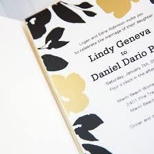 floral foil black and gold floral foil pressed pocket wedding invitations with