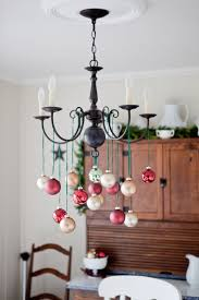 Christmas Decoration For Chandelier by 10 Awesome Ways To Decorate With Leftover Christmas Ornaments