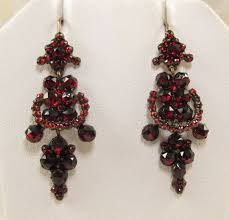garnet earrings fiery bohemian garnets adorn these articulated earrings
