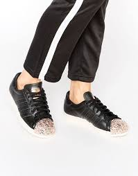 buy football boots worldwide shipping adidas originals black superstar trainers with copper metal toe