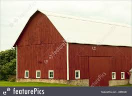 picture of old red barn on a stone foundation