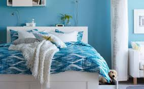 light blue bedroom walls with dark furniture bedding to match