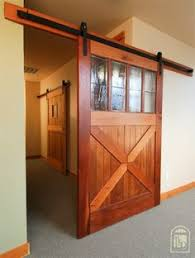 Sliding Barn Doors A Practical Solution For Large Or by Turn A Regular Door Into A Sliding Barn Door Barn Doors Barn