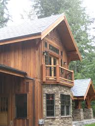 like the vertical siding rustic feel bavarian stone cabin timber
