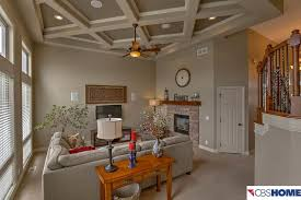 traditional living room with box ceiling u0026 specialty door in
