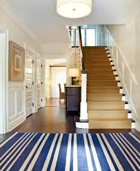 rugs striped blue entryway rug ideas with wood stairs and wall