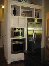 next kitchen furniture wall ovens next to refrigerator in kitchen by burrows cabinets