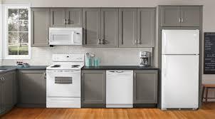 white appliances dark kitchen cabinets kitchen
