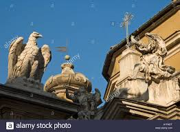 rooftop ornamental statues in the vatican city italy stock photo