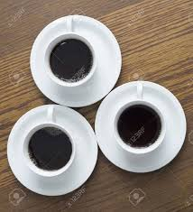 3 cup of coffee on wood table photo from top stock photo picture