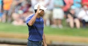 tiger woods shows flashes of brilliance but poor putting mother