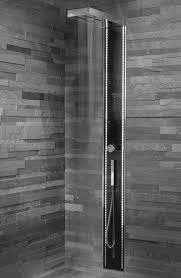 brown mosaic tile bathtub wall surround with steel rain of