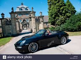 porsche 911 front stylish woman and porsche 911 in front of castle 911 carrera 4s