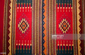 closeup of aztec indian rug with colorful wool and exquisite