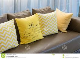 living room with brown sofa and yellow pillows stock photo image
