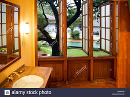 garden view from dutch colonial style bathroom attached to guest