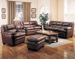 dark brown living room furniture cream wall with glass windows and brown curtains completed with
