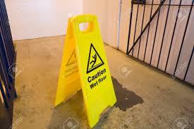 Wet Floor Images by Wet Floor Hazard Sign Yellow With Caution Symbol Stock Photo