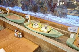 your sushi arrives via little floating boats at this new sterling